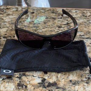 Black Oakley sunglasses with soft case.